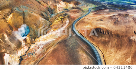 Aerial panoramic view on road in Iceland. Aerial landscape above highway in the geysers valley. 64311406