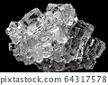 Cubic salt crystal aggregate against black 64317578
