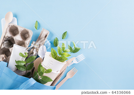 Different garbage materials on blue background. 64336066