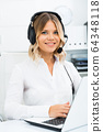 Friendly girl technical support person or call center manager in the office 64348118