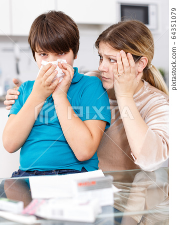 Sick boy with mother at home 64351079
