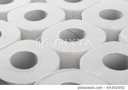 Group of toilet paper rolls background 64392692