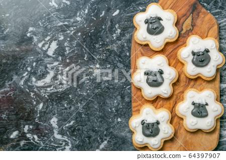 Eid Ad-Adha Mubarak holiday concept - cookies shaped like sheeps 64397907