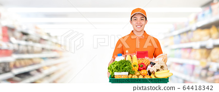 Hygienic smiling Asian delivery man carrying grocery tray 64418342
