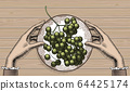 Bunch of grapes on a plate. 64425174