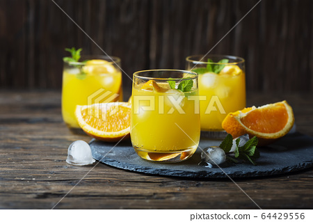 Fresh summer cocktail with orange and mint 64429556