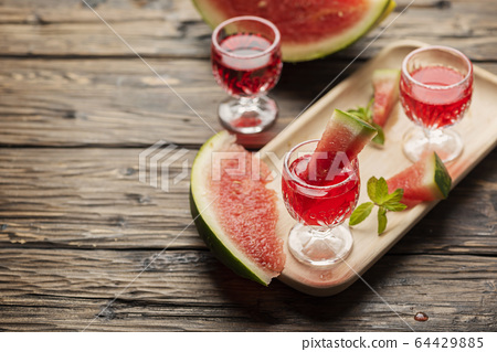 Sweet alcohol liquor with watermelon 64429885