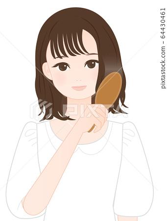 Woman combing hair 64430461