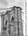 Black and white upward image of the Brooklyn Bridge in New York 64439467