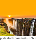 Sunset over Victoria Falls with orange sky 64458263