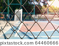 Iron net with blur football field background. 64460666