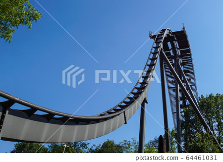 Rollercoaster track against a brilliant blue sky 64461031