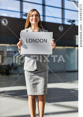 Portrait of attractive woman standing while 64465675
