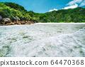 Shallow lagoon on Anse Cocos beach, La Digue island, Seychelles 64470368