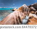 Bizarre formed rocks on Anse Cocos beach, La Digue island, Seychelles. Blue ocean bay in background 64470372