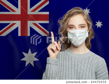 Woman in medical mask pointing up 64470459