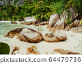 La Digue, Seychelles. Jungle hike trip around the island visiting hidden most remote secluded beautiful beach 64470736