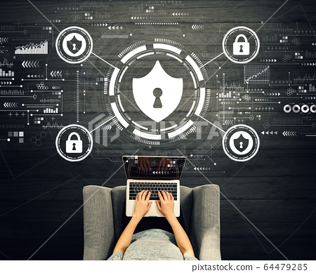 Cyber security theme with person using a laptop 64479285