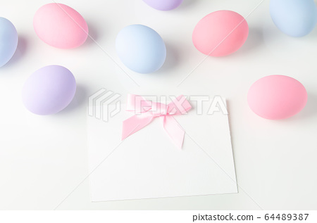 Blank white greeting card with pink ribbon bow and 64489387