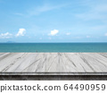 Empty concrete table top on sea and sky blurred background. 64490959