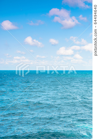 sea and sky. calm seascape with clouds on the 64494640