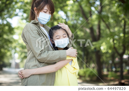 mother and child wear face mask during coronavirus 64497820