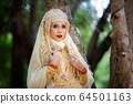 Portrait Of Young Bride Wearing wedding Hijab Standing outdoor 64501163