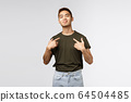 Portrait of proud and boastful young asian macho man, show-off his big ego, pointing at himself with pleased bragging smile, look camera, talking about personal achievement, grey background 64504485