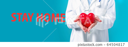 Stay home theme with a doctor holding a heart 64504817