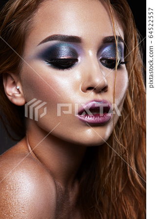 Beautiful young model with bright make-up. Blue eyeshadow 64522557