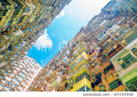 Old residential building under blue sky at Quarry Bay, Hong Kong 64540986
