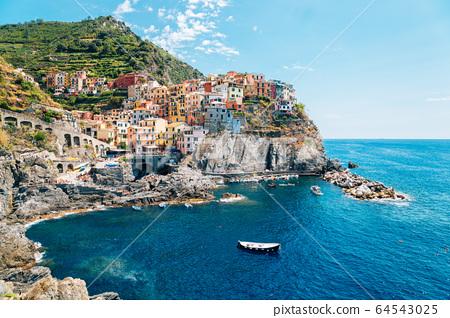 Seaside village Manarola, Colorful buildings and beach in Cinque Terre, Italy 64543025