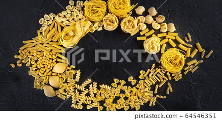 Italian pasta panoramic design with copyspace, a flatlay of many pasta types, shot from above on a black background 64546351