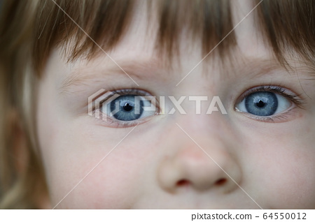 Charming toddler look, funny eyes little girl 64550012