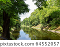 Fosa Miejska river and green trees in Wroclaw, Poland 64552057