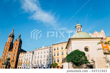 Church of St. Adalbert (Wojciech) and St. Mary's Basilica at Main Market Square (Rynek Glowny) in Krakow, Poland 64552983