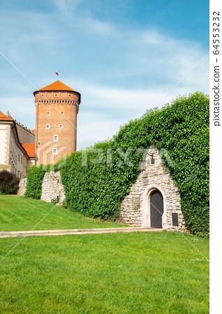 Wawel castle tower with garden in Krakow, Poland 64553232