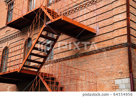 Fire escape stairs and old brick building in Khabarovsk, Russia 64554956