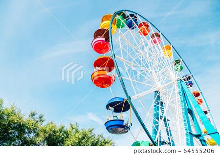 Colorful ferris wheel at amusement park in Vladivostok, Russia 64555206