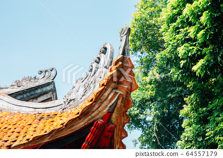 Traditional roof at Temple of literature in Hanoi, Vietnam 64557179