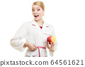 Doctor specialist holding fruit apple measuring 64561621