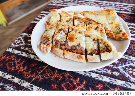 Turkish traditional food pide, baked bread with meat and cheese 64563407