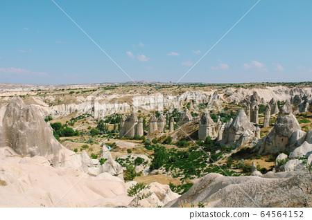 Cavusin old village, cave town in Cappadocia, Turkey 64564152