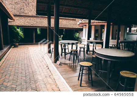 Ancient City Mueang Boran, old table and chair on wooden floor in Samut Prakan, Thailand 64565058