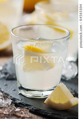 Homemade lemonade with lemon and ice 64565894