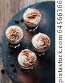 Delicious coffee with crean and cocoa 64566366