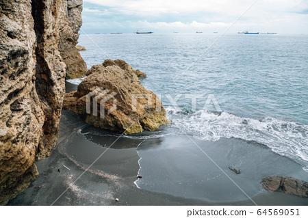 Cijin beach and cliff in Kaohsiung, Taiwan 64569051