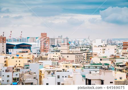 Colorful buildings under blue sky in Cijin island, Kaohsiung, Taiwan 64569075