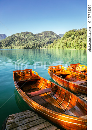 Lake Bled and wooden boats in Slovenia 64578896