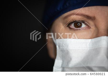 Female Doctor or Nurse Wearing Medical Face Mask 64580021